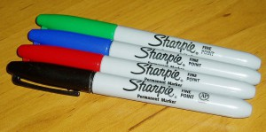 Black, red, blue, and green permanent markers