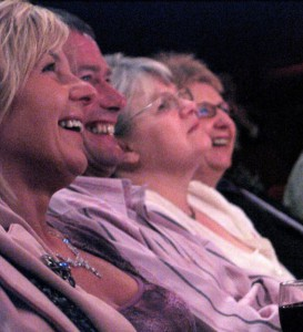 People laughing during a comedy club performance
